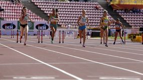 Athletes running 400 metres hurdles in the IAAF World U20 Championship in Tampere, Finland 11 July, 2018. royalty free stock photo