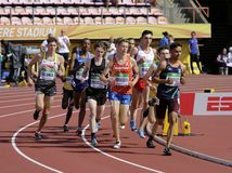 Athletes running 1500 metres in the IAAF World U20 Championship in Tampere, Finland 10th July, 2018. royalty free stock photos