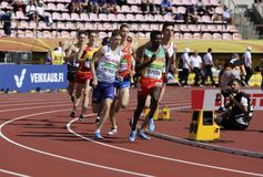Athletes running 1500 metres in the IAAF World U20 Championship in Tampere, Finland 10th July, 2018. TAMPERE, FINLAND, July 10: Athletes running 1500 metres in stock photography