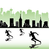 Athletes running near a city Stock Image