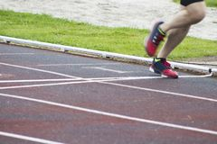 Athletes running outdoors. Athletes running on the athletics track Royalty Free Stock Photography