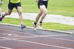 Athletes running outdoors. Athletes running on the athletics track Stock Images