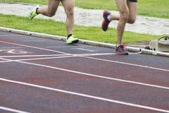 Athletes running outdoors. Athletes running on the athletics track Stock Photography