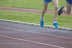 Athletes running, sports. Athletes running on the athletics track Royalty Free Stock Photos