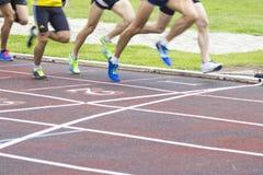 Athletes running, sports. Athletes running on the athletics track Royalty Free Stock Photography
