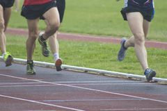 Athletes running, sports. Athletes running on the athletics track Stock Photo
