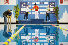 Athletes of Russia and China stand on victory podium Stock Images
