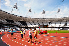 Athletes shaking hands in olympic stadium. Athletes at the Visa London Disability Athletics Challenge at the Olympic Stadium in London on May 8, 2012. The event Royalty Free Stock Photos