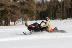 Athletes on a snowmobile. Royalty Free Stock Image