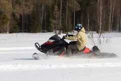 Athletes on a snowmobile. Stock Images