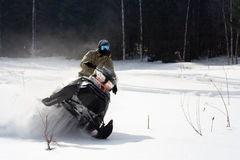 Athletes on a snowmobile. Stock Photography