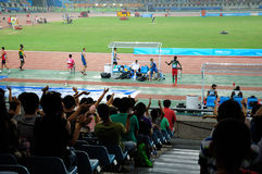 Athletes and spectators Stock Images