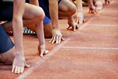 Athletes at the sprint start line. In track and field Stock Photo
