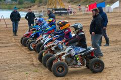 Athletes on the start line. SERPUKHOV, RUSSIA - OCTOBER 7, 2017: Juniors before start,  Class ATV-JUNIORS, in the 4 stage  MX series, the Red Wings Cup 2017 Stock Images