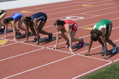 Athletes At Start Of Running Track Royalty Free Stock Images