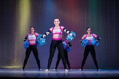 Athletes take the stage, young cheerleaders perform at the cheerleading championship.  stock photography
