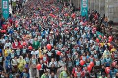 Athletes taking part in Stramilano half marathon. MILAN, ITALY - MARCH 23: Athletes take part in Stramilano, traditional half marathon through the city streets Royalty Free Stock Photography