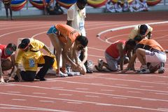 Athletes on track Royalty Free Stock Images
