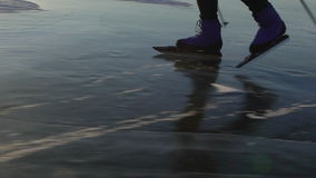 Athletes train at Lake Baikal. Close up view of foot of man are skating on the ice of frozen Baikal during sunset. Outdoor winter fun for athlete nice winter stock footage