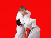 Athletes train reception capture his head on a red background Royalty Free Stock Images