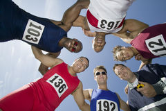 Athletes With Trainer Forming A Huddle Stock Photos