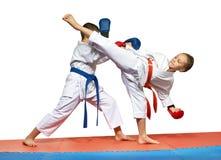 Athletes are training  beat Ura mavashi geri and protection against it Royalty Free Stock Photography