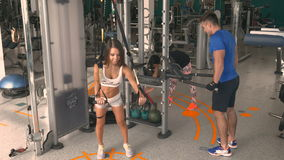 Athletes are training on the simulators in the gym stock video footage