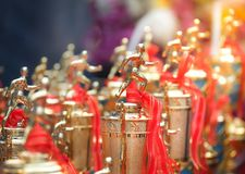 Athletes trophy cup awards with a red ribbon. Group of runner trophy on the blue background royalty free stock photos