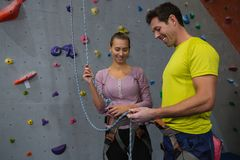 Athletes tying ropes in fitness club Royalty Free Stock Images