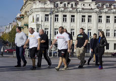 Athletes walk on the city Stock Images