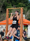 Athletes warm up. A woman warms up before the race, at  the July 2014 mudathlon in northwest Indiana Royalty Free Stock Photos