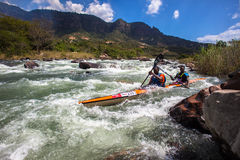 Athletes Water Rapids Canoe Race. Doubles team Mbandwa and Zondi in the fast river rapids with there canoe at mid day the Non Stop Dusi canoe marathon. Photo Royalty Free Stock Photography