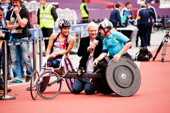 Athletes on wheelchairs inteviewed. Athletes interviewed at the Visa London Disability Athletics Challenge at the Olympic Stadium in London on May 8, 2012. The Royalty Free Stock Images