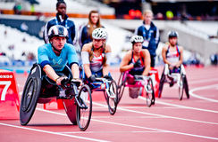 Athletes on wheelchairs in the olympic stadium. LOAthletes at the Visa London Disability Athletics Challenge at the Olympic Stadium in London on May 8, 2012. The Royalty Free Stock Photo