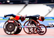 Athletes on wheelchairs racing. Intentionally motion blurred athletes at the Visa London Disability Athletics Challenge at the Olympic Stadium in London on May 8 Royalty Free Stock Photography