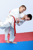 Athletes with a white and red sash do judo throw. Athletes with a red and white sash do judo throw stock photos