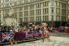 Athletes in the Women's Olympic Marathon 2012. Athletes pass the statue of Queen Victoria in St Paul's Churchyard for the 2nd time during the Olympic Women's Stock Photography