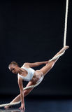 Athletic aerialist posing with rope Stock Images
