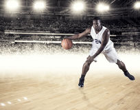 Athletic African American Basketball Player dribbling the ball Royalty Free Stock Photos