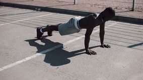 Athletic African American man doing push-ups. Cross fit training. Workout, fitness, running, motivation. Athletic African American man doing push-ups. Cross fit stock footage