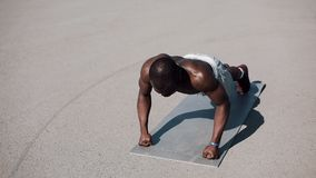 Athletic African American man doing push-ups. Cross fit training. Workout, fitness, running, motivation. Athletic African American man doing push-ups. Cross fit stock video footage