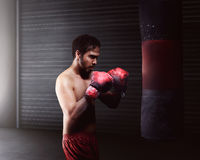 Athletic asian man workout boxing Stock Photography