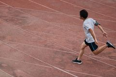 Athletic Asian runner sprinter crossing the finish line. Athletic Asian runner sprinter crossing the finish line . Competition run concept Royalty Free Stock Photos