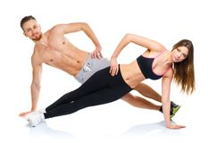 Athletic attractive couple - man and woman doing fitness exercis Royalty Free Stock Photography