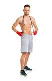 Athletic attractive man with a rope on the white Royalty Free Stock Images