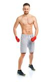 Athletic attractive man wearing boxing bandages on the white Royalty Free Stock Photography