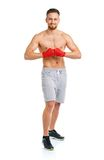 Athletic attractive man wearing boxing bandages on the white Stock Photography