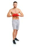 Athletic attractive man wearing boxing bandages on the white Stock Images