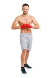 Athletic attractive man wearing boxing bandages on the white Royalty Free Stock Image