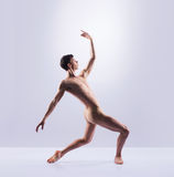Athletic ballet dancer in a perfect shape performing royalty free stock images